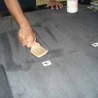 scrub carpet grease
